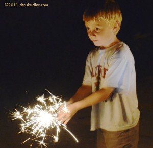 Nephew and sparkler on July 4, 2011. Photo by Chris Kridler, chriskridler.com