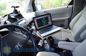 Here's a laptop mount I made for my storm-chasing vehicle with PVC pipe and a cutting board. Photo by Chris Kridler, ChrisKridler.com, SkyDiary.com