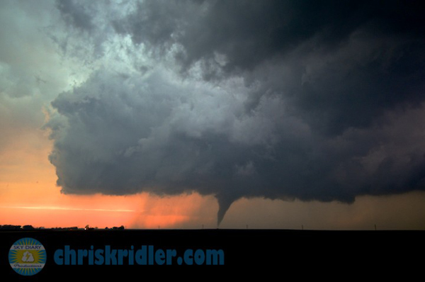 A tornado and wall cloud are backlit by the setting sun west of Larned, Kansas, on May 18, 2013. Photo by Chris Kridler, ChrisKridler.com, SkyDiary.com