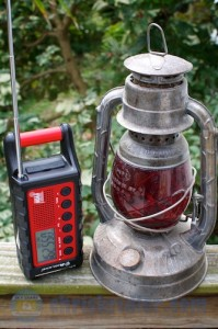 MIdland's ER300 weather radio is shown with an old railroad lantern for size comparison. Photo by Chris Kridler, ChrisKridler.com