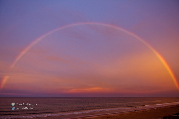 A rainbow glows in the sunset-orange sky at Indialantic, Florida, on Aug. 16, 2014. Photo by Chris Kridler, ChrisKridler.com, SkyDiary.com